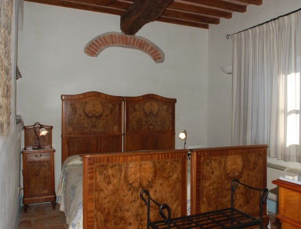 podere-alberese-asciano-toscane-slaapkamer.jpg