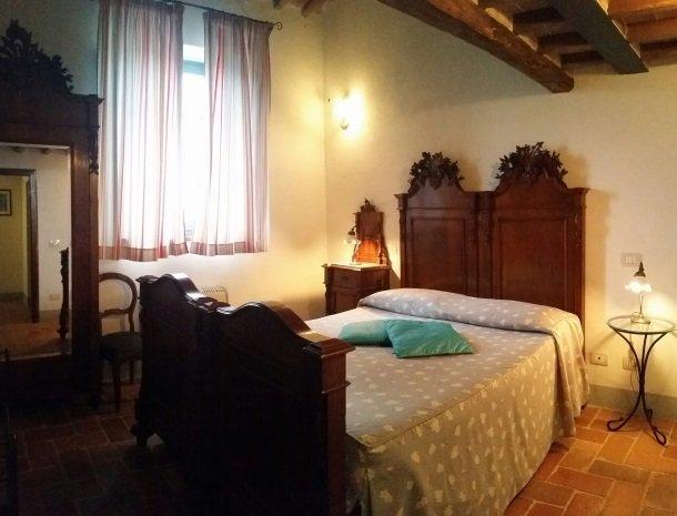 podere-alberese-asciano-toscane-slaapkamer-pergola.jpg