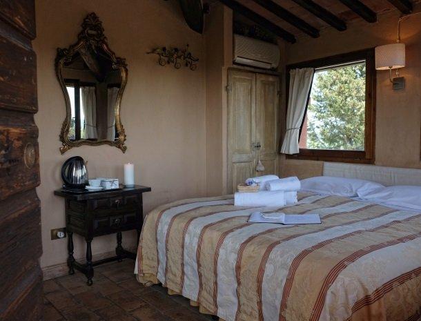 agriturismo-pieve-sprenna-slaapkamer.jpg
