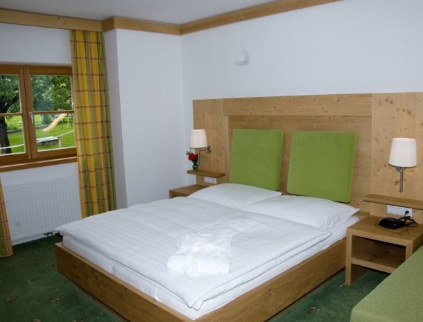 tierwarthof-fieberbrunn-appartement-slaapkamer-bed.jpg
