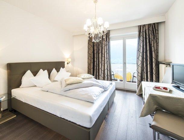 hotel-pension-verdorfer-merano-slaapkamer-bed.jpg