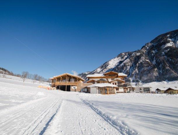 feriendorf-ponyhof-fusch-grossglockner-winter-zon-sneeuw.jpg
