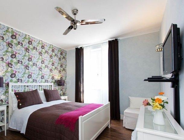 villa-amaranta-la-spezia-slaapkamer-bed.jpg