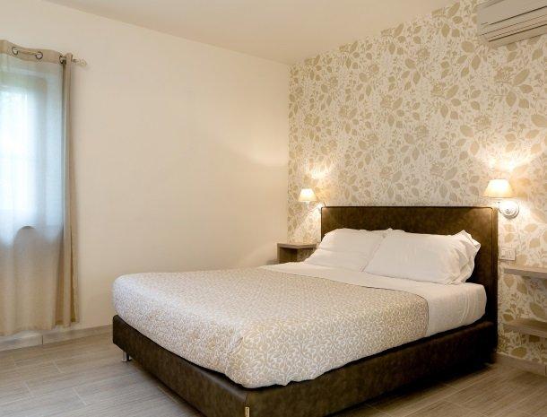 tenuta-lamborghini-umbrie-suite-rosa-bed.jpg