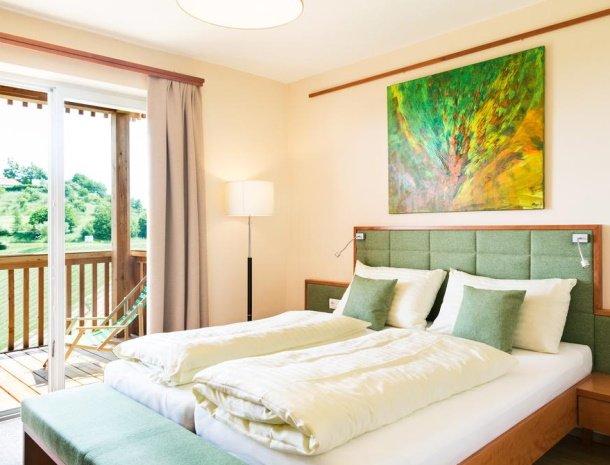 weingut-dreisiebner-steiermark-slaapkamer-balkon.jpg