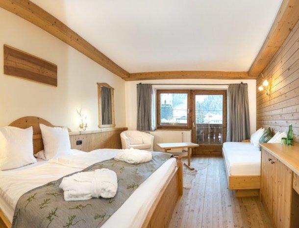 frohnatur-garni-hotel-thiersee-slaapkamer-extra-bed.jpg