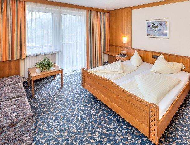 hotel-sailer-wenns-kinderhotel-kamer-bed.jpg