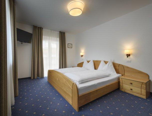 garni-august-ortisei-trentino-slaapkamer-standaard.jpg