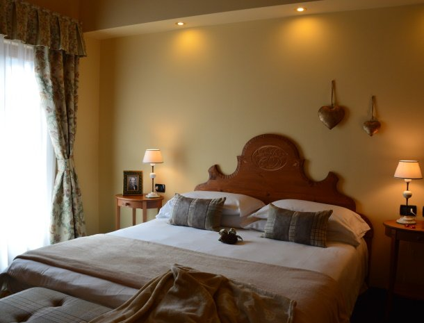 hotel-carpe-diem-vigo-di-fassa-trentino-slaapkamer.jpg