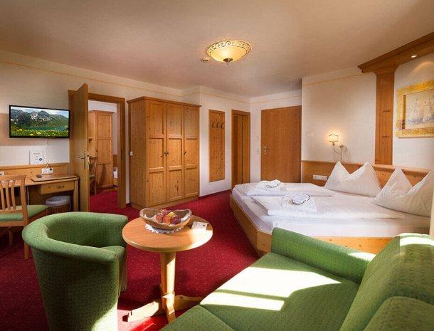 hotel-bergzeit-grossarl-familiekamer-bed.jpg