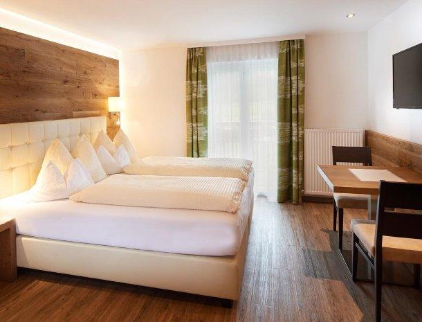 hotel-jaegerheim-flachau-slaapkamer-zithoek.jpg