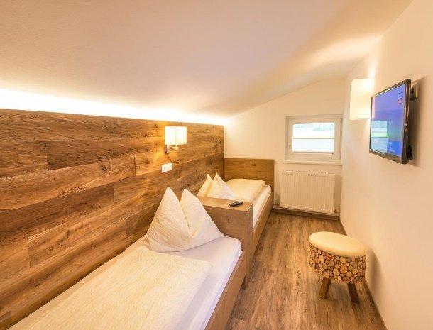 appartementen-jaegerheim-flachau-slaapkamer-losse-bedden.jpg
