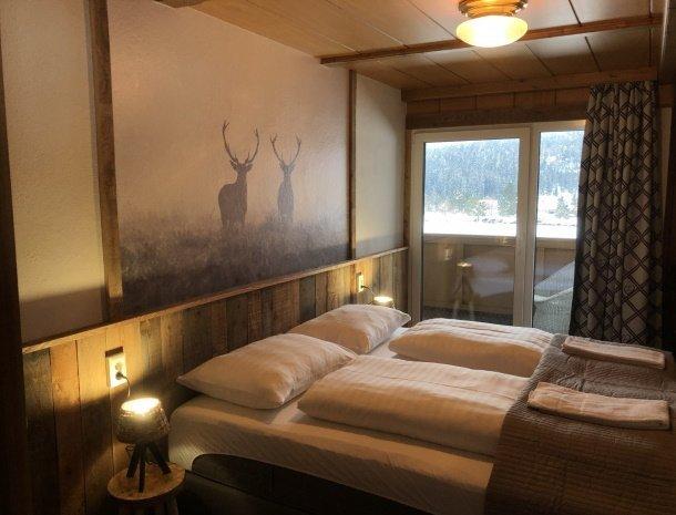 landhaus-kloosterstube-hermagor-karinthie-stube-large-slaapkamer-balkon.jpg